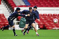 Photo: Scott Heavey, Digitalsport.<br /> Chelsea training session at Highbury. 05/04/2004.<br /> Joe Cole tries to escape his team-mates