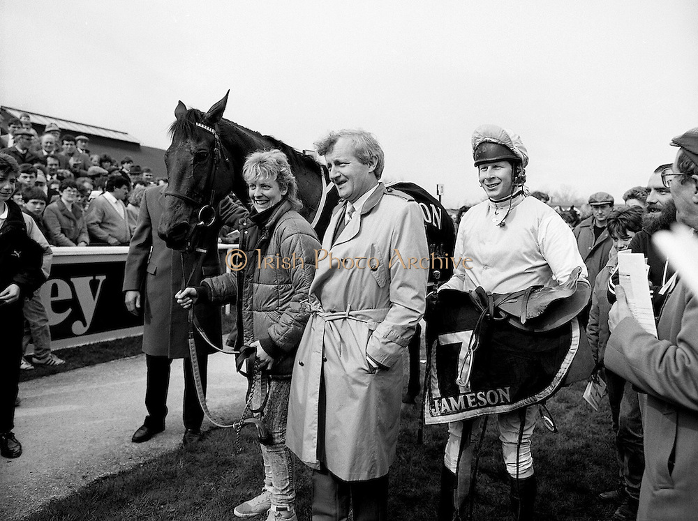 The Easter Racing Festival at Fairyhouse, County Meath, includes the running of the Irish Grand National and the Jameson Gold Cup. Here the stable girl, owner and winning jockey pose for pictures with the winning horse, Brittany Boy, in the winner's enclosure.<br />
