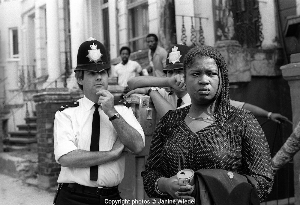 People watching the Notting Hill Carnival go by from their doorsteps in 1976