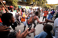 Supporters of Haitian presidential candidate Michel Martelly clashed with security personnel guarding the office of political rival Jude Celestin. Many Haitians took to the streets in protest after preliminary results were announced the night before.
