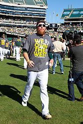 OAKLAND, CA - SEPTEMBER 22: Sean Doolittle #62 of the Oakland Athletics celebrates after the game against the Minnesota Twins at O.co Coliseum on September 22, 2013 in Oakland, California. The Oakland Athletics defeated the Minnesota Twins 11-7 as they clinched the American League West Division. (Photo by Jason O. Watson/Getty Images) *** Local Caption *** Sean Doolittle