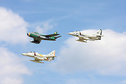 An F-86 Sabrejet and two A-4 Skyhawks fly in formation.