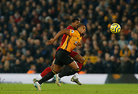 Football - 2019 / 2020 Premier League - Liverpool vs. Wolverhampton Wanderers<br /> <br /> Adama Traore of Wolves is challenged by Georginio Wijnaldum of Liverpool in midfield, at Anfield.<br /> <br /> COLORSPORT/ALAN MARTIN