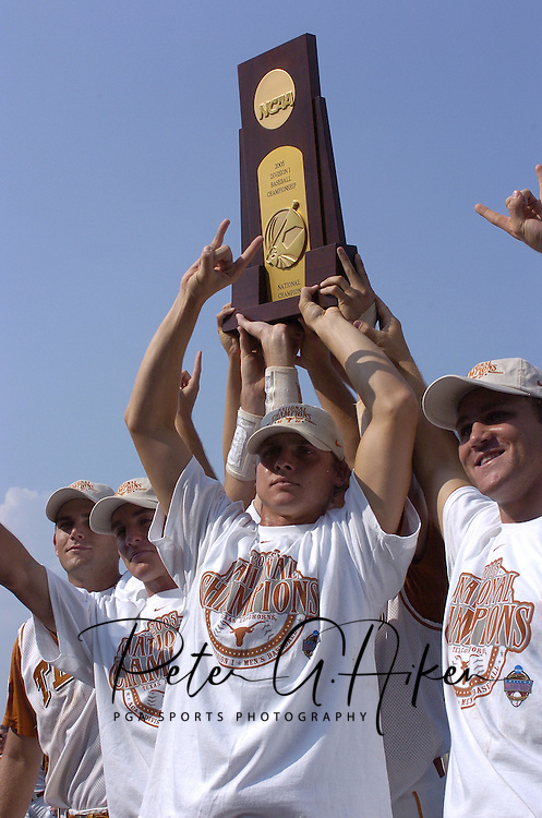 The Texas Longhorns hold up the National Championship Trophy, after defeating the University of Florida.  Texas defeated Florida 6-2 for the National Championship at the College World Series at Rosenblatt Stadium in Omaha, Nebraska on June 26, 2005.