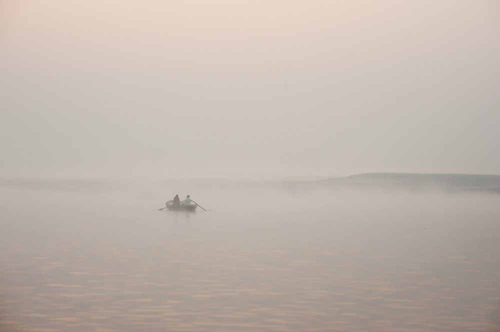 Boat on the Ganges river at Varanasi at dawn (India)