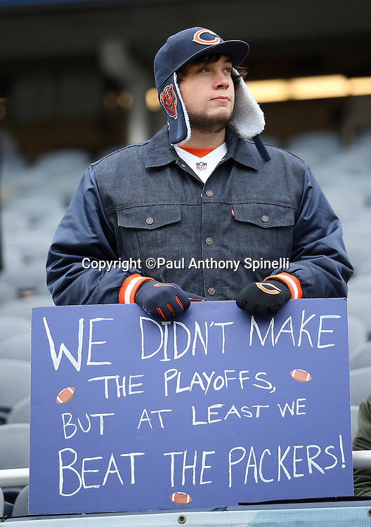 "A Chicago Bears fan holds up a sign stating ""We didn't make the playoffs but at least we beat the Packers"" during the Chicago Bears NFL week 17 regular season football game against the Detroit Lions on Sunday, Jan. 3, 2016 in Chicago. The Lions won the game 24-20. (©Paul Anthony Spinelli)"