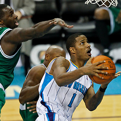 December 28, 2011; New Orleans, LA, USA; New Orleans Hornets small forward Trevor Ariza (1) looks to shoot as Boston Celtics power forward Brandon Bass (30) defends during the fourth quarter of a game at the New Orleans Arena. The Hornets defeated the Celtics 97-78.  Mandatory Credit: Derick E. Hingle-US PRESSWIRE
