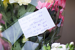 © Licensed to London News Pictures. 24/05/2017. Manchester, UK. Picture shows flowers outside Manchester Town hall this morning in memory of those who lost their lives in the Manchester bomb at the Manchester Arena. Photo credit: London News Pictures