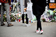 Paris | 03 December 2015<br /> <br /> On the evening of 13 November 2015, a series of coordinated terrorist attacks occurred in Paris, the capital of France, and its northern suburb, Saint-Denis. Beginning at 21:20 CET, three suicide bombers struck near the Stade de France in Saint-Denis, followed by suicide bombings and mass shootings at caf&eacute;s, restaurants and the music venue Bataclan in Paris.<br /> The attackers killed 130 people (state of Dec 09, 2015), including 89 at the Bataclan, where they took hostages before engaging in a stand-off with police forces. There were 368 injuries. Seven of the attackers also died.<br /> The attacks were the deadliest on France since World War II and the deadliest in the European Union since the Madrid train bombings in 2004.<br /> Here: A woman is seen with baguette white bread in her shopping bag standing at a mourning site at Le Comptoir Voltaire (formerly Le Caf&eacute; Bonal),<br /> 253 Boulevard Voltaire.<br /> <br /> &copy;peter-juelich.com<br /> <br /> [No Model Release | No Property Release]