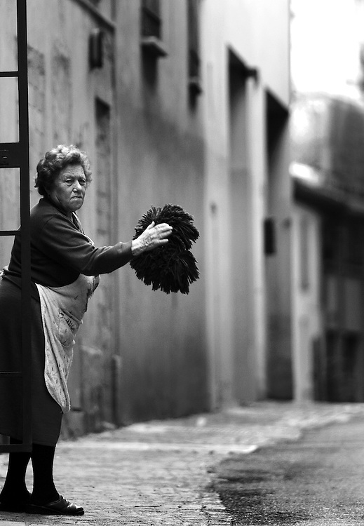 Woman cleaning in Bologna Italy.