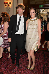 ALEX JAMES and his wife CLAIRE at the GQ Men Of The Year 2014 Awards in association with Hugo Boss held at The Royal Opera House, London on 2nd September 2014.