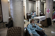A medical team is shown with a field hospital set up in the lobby of the Ukraine Hotel off Maidan Square on February 20, 2014 in Kiev, Ukraine. This medical post was the closest to the shooting spots where Ukrainian security forces fired live ammunition and at least 70 people died in the morning, according to published reports quoting medical workers who were treating the victims.