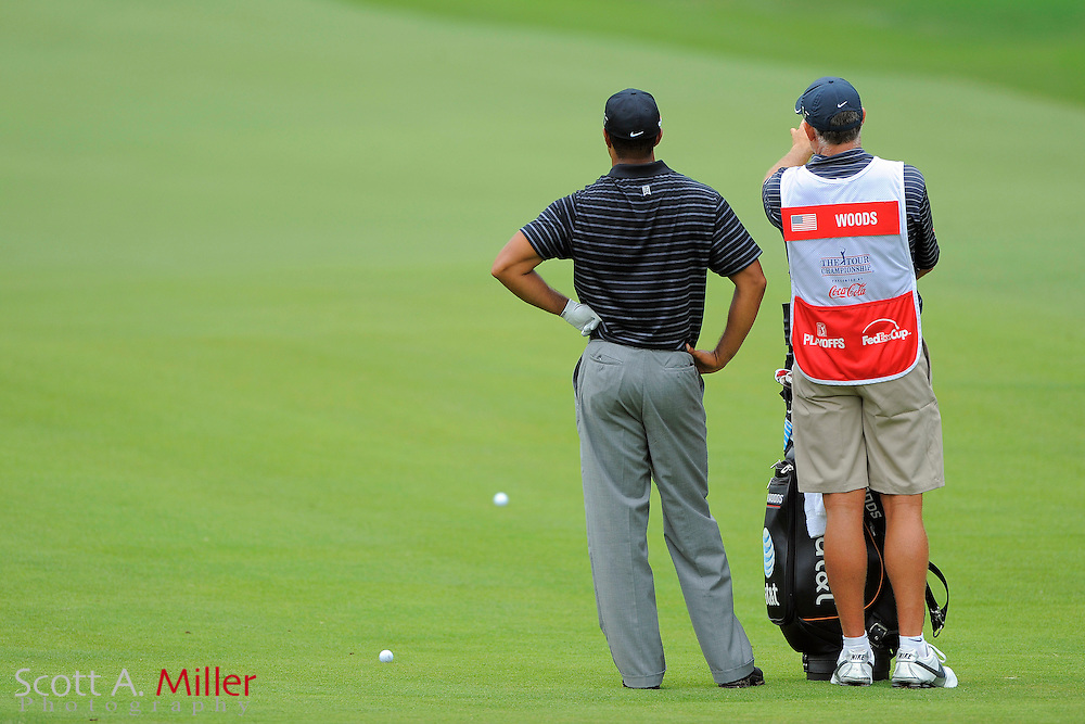 Tiger Woods (USA) and his caddie Steve Williams on the fifth hole hole during the third round of the PGA Tour Championship the final event of the 2009 FedEx Cup at East Lake Golf Club on Sept. 26, 2009 in Decatur, Ga.     ..©2009 Scott A. Miller