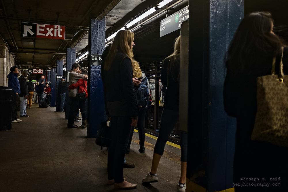Couple embracing on subway platform, New York, NY, US