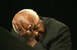 Archbishop Desmond Tutu wipes away a tear during an emotional moment while attending the launch of humanitarian formation called The Elders by former president Nelson Mandela, who celebrates his 89th birthday today, in Johannesburg, Wednesday, 18 July 2007. World leaders like ex US president Jimmy Carter, former Irish president Mary Robinson and former United Nations secretary general Kofi Annan will be part of group who will tackle the world's toughest problems. Picture: Werner Beukes/SAPA