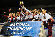 The University of Alabama celebrates after being awarded national champions at the 2011 Women's NCAA Gymnastics Championship Team Finals on April 16, in Cleveland, OH. (photo/Jason Miller)
