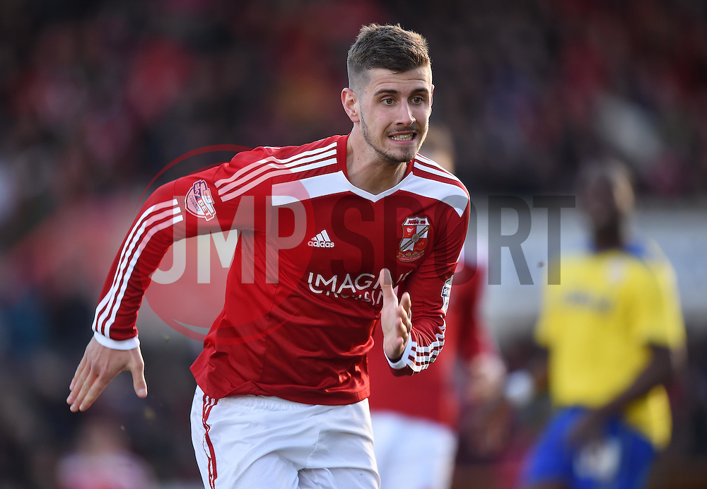 Swindon Town's Jack Stephens in action during the Sky Bet League One match between Swindon Town and Crawley Town at The County Ground on 21 February 2015 in Swindon, England - Photo mandatory by-line: Paul Knight/JMP - Mobile: 07966 386802 - 21/02/2015 - SPORT - Football - Swindon - The County Ground - Swindon Town v Crawley Town - Sky Bet League One