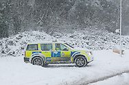 Ministry of Defence Police patrol the perimeter their site in Corsham as heavy overnight snow causes disruption in rural Wiltshire. January 18 2013. Corsham, UK..Photo by: Mark Chappell/i-Images