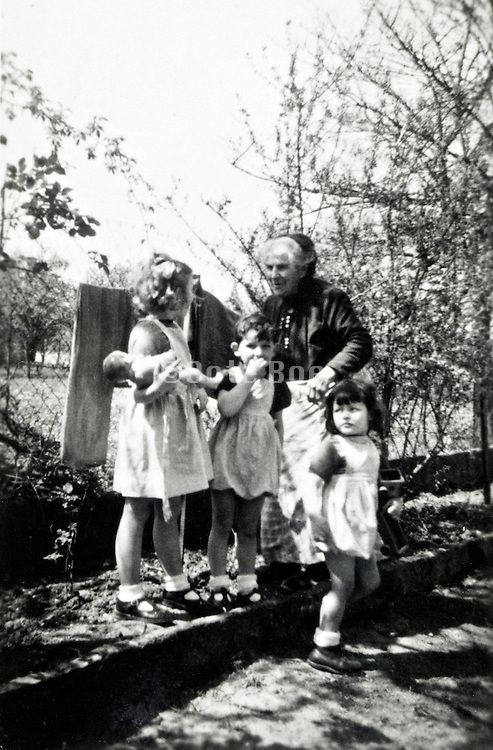 grandmother with three little children France 1950s