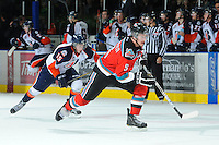 KELOWNA, CANADA, OCTOBER 29: Mitchell Chapman #5 of the Kelowna Rockets and Tim Bozon #15 of the Kamloops Blazers skate for the puck as Kamloops Blazers visit the Kelowna Rockets  on October 29, 2011 at Prospera Place in Kelowna, British Columbia, Canada (Photo by Marissa Baecker/Shoot the Breeze) *** Local Caption *** Mitchell Chapman; Tim Bozon;
