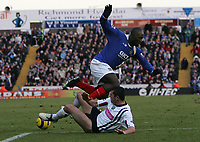 Photo: Lee Earle.<br /> Portsmouth v West Bromwich Albion. The Barclays Premiership. 17/12/2005. West Brom's Paul Robinson (R) slides in on Lomana Lua Lua.