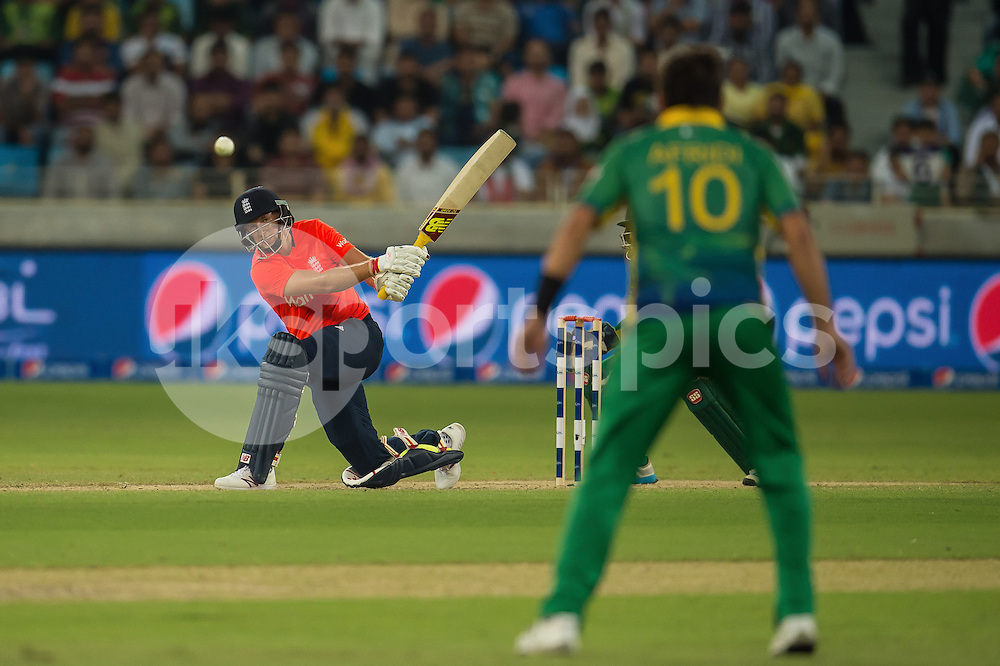 Joe Root of England hits directly at Shahid Afridi, Captain of Pakistan during the 2nd International T20 Series match between Pakistan and England at Dubai International Cricket Stadium, Dubai, UAE on 27 November 2015. Photo by Grant Winter.