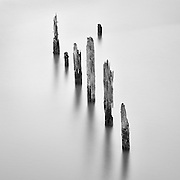 Seven Pilings, Columbia River, Astoria, Oregon. Hundred-year-old pilings along Astoria's waterfront, that once supported a thriving fish processing and packing industry, Astoria, Oregon, USA.