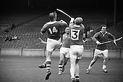 17/08/1969<br /> 08/17/1969<br /> 17 August 1969<br /> All-Ireland Junior Semi-Final: Kerry v Louth at Croke Park, Dublin.<br /> Kerry full-forward, L. MacCarthaigh (14), and Kerry left forward, S. MagFhionntain (right) in a tussle with Louth backs S. O'Dulainne (3) and S. Breathnach.