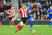 Duncan Watmore (14) Sunderland AFC striker and Leicester City's defender Christian Fuchs (28)  during the Premier League match between Sunderland and Leicester City at the Stadium Of Light, Sunderland, England on 3 December 2016. Photo by Ian Lyall.