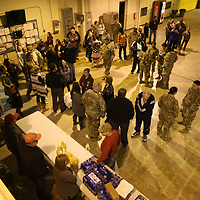 Family and friends join members of the 155th Headquarters Headquarters Company Tuesday morning before they leave their facilites in Tupelo for training at Fort Bliss and then a deployment to the Middle East later this year.