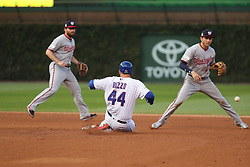 October 9, 2017 - Chicago, IL, USA - Chicago Cubs first baseman Anthony Rizzo (44) advances to second after a throwing error in the fourth inning of Game 3 of a National League Division Series playoff on Oct. 9, 2017 at Wrigley Field in Chicago. (Credit Image: © Christopher Sweda/TNS via ZUMA Wire)