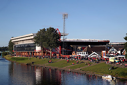 Nottingham Forest fans make their way along the river Trent to the City Ground ahead of the match