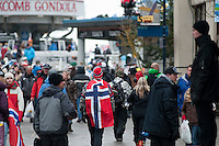 A fan wearing a Norwegian Flag walks to the Blackcomb Gondola during the 2010 Olympic Winter Games in Whistler, BC Canada.