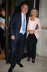 Leader of the Conservative Party MICHAEL HOWARD MP and his wife SANDRA at the Conservative party Pre-Conference Season party hosted by Lord Saatchi and Lord Strathclyde and held at M&C Saatchi, 36 Golden Square, London W1 on 7th September 2004.