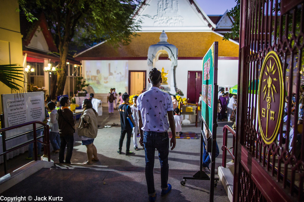 27 JANUARY 2013 - BANGKOK, THAILAND:  People walk into the temple for Thaipusam at Dhevasathan (the Brahmin Shrines) on Dinso Rd in Bangkok. Thaipusam is a Hindu festival celebrated primarily by the Tamil community in South East Asia on the full moon in the Tamil month of Thai (Jan/Feb). Pusam refers to a star that is at its highest point during the festival. The festival commemorates both the birthday of the Hindu god Murugan, son of Shiva and Parvati, and the occasion when Parvati gave Murugan a vel (a lance) so he could vanquish the evil demon Soorapadman. The holy day is celebrated by Brahmins in Thailand. Brahmanism was the court religion before Buddhism came to Thailand and before the foundation of Sukhothai. Both religions are combined in the Thai way of life and its customs and ceremonies.       PHOTO BY JACK KURTZ