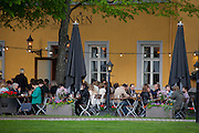 Outdoor cafe near the harbor in Oslo, Norway on a warm summer evening.