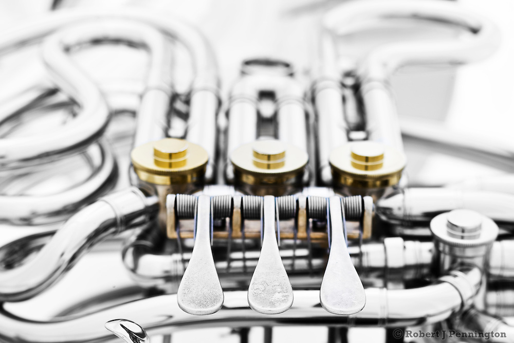 Detail of the complex path of tubing and valves on a French Horn.