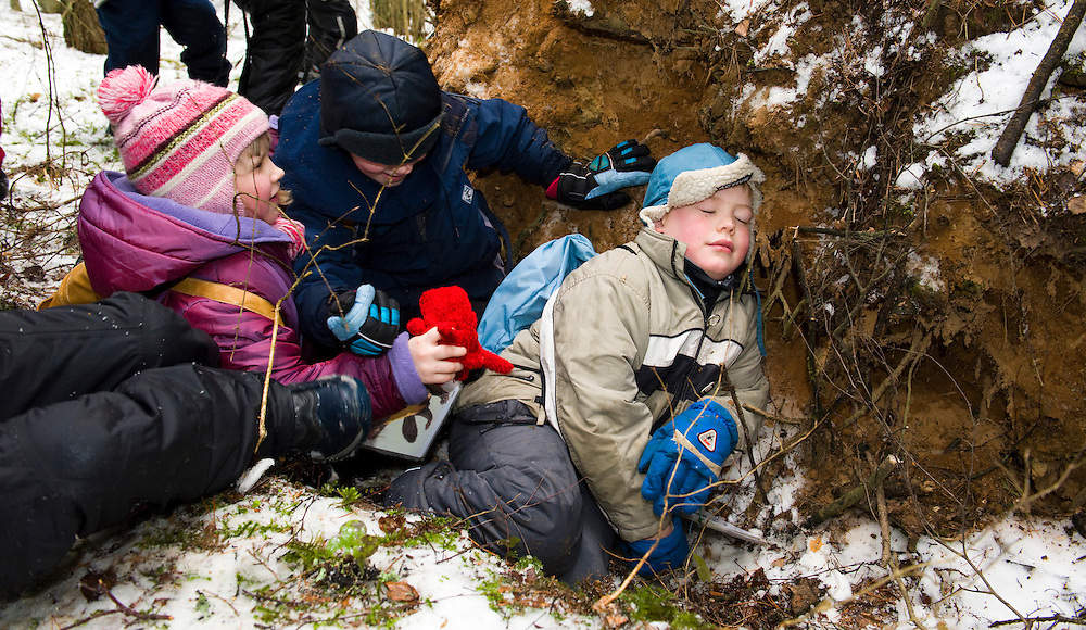A group of Estonian school children in the woods pretending to be bears
