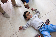 Mourhaf is six years old. He was born both deaf and blind. He likes to lay on the floor of the classroom.