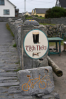 hand painted stone sign for bicycle hire and traditional guinness stout  sign for a local bar on Inis Oirr on the Aran Islands Galway Ireland