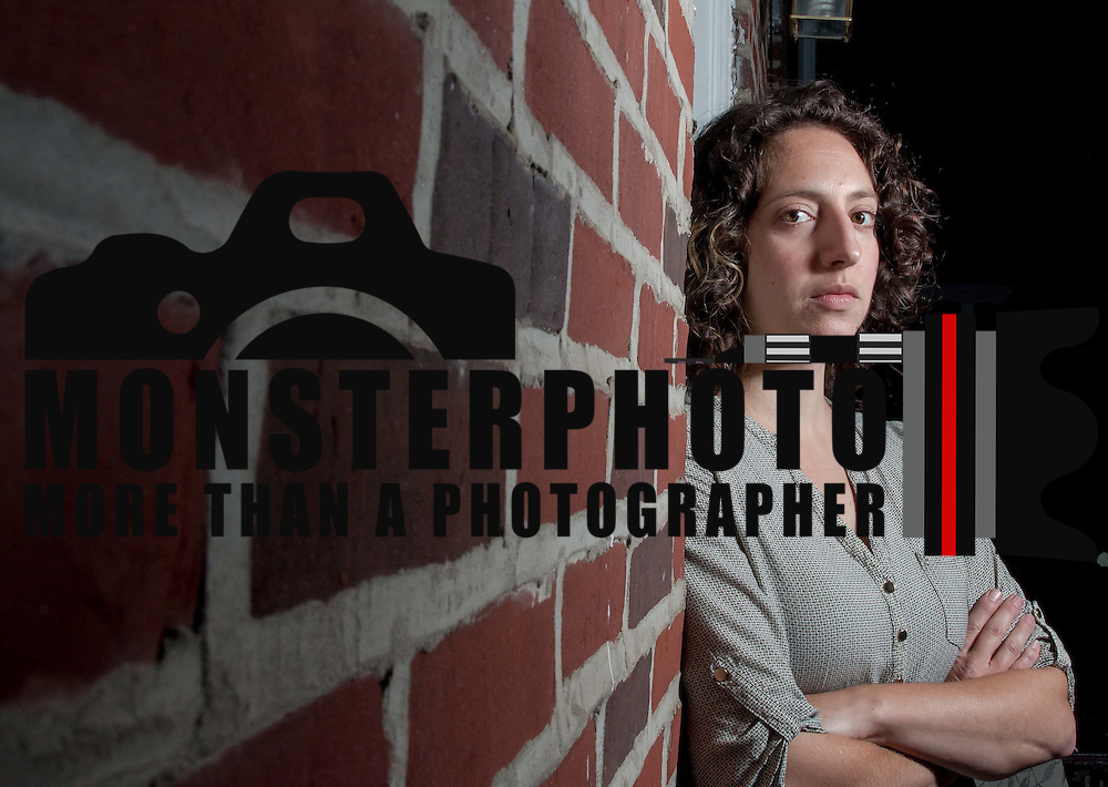 Sarah Green who launched an online petition to change the name of Murder Town poses for a portrait Monday, Nov. 16, 2015 in Wilmington.