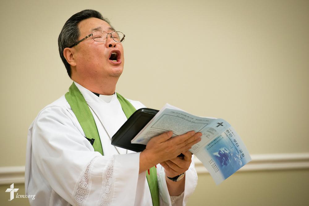 The Rev. Chang Soo Kim sings during Divine Service on Sunday, Nov. 23, 2014, at Living Faith Korean Lutheran Church in Cumming, Ga. LCMS Communications/Erik M. Lunsford