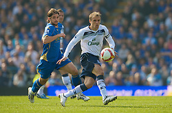 PORTSMOUTH, ENGLAND - Saturday, March 21, 2009: Everton's Phil Neville in action against Portsmouth during the Premiership match at Fratton Park. (Photo by David Rawcliffe/Propaganda)