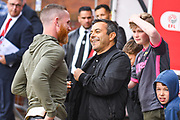 Leeds United owner Andrea Radrizzani and Leeds United midfielder Adam Forshaw (4) during the EFL Sky Bet Championship match between Barnsley and Leeds United at Oakwell, Barnsley, England on 15 September 2019.