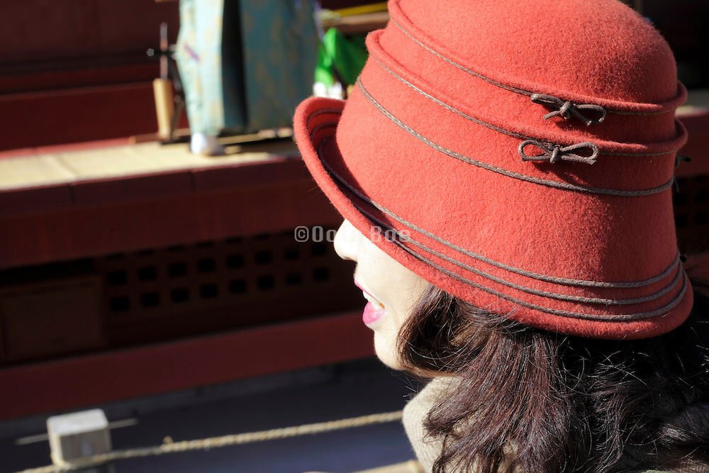 side view of an fashionable dressed Asian woman