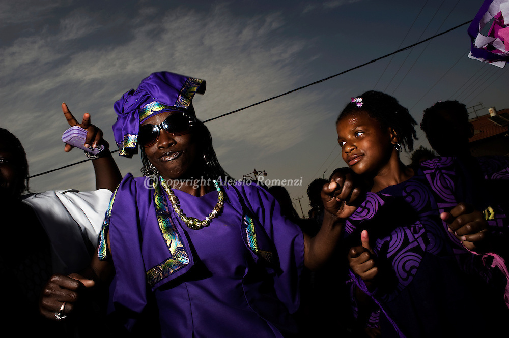 Members of the Hebrew Israelite community dance while parading through the southern Israeli city of Dimona attending the Passover holiday celebrations to mark the 42nd anniversary of their arrival to Israe, on May 27, 2010. The holiday commemorates the day they left Chicago for Liberia before moving to the Holy Land. The community, which approximately includes 2000 members, arrived in Israel in 1969 and has since then maintained a vibrant culture which includes a communal lifestyle and a vegan diet. Hebrew Israelites believe in the Torah and in polygamy.© ALESSIO ROMENZI