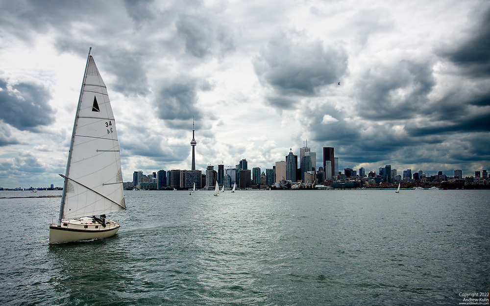Sailboats out in Toronto Harbour with threatening skies
