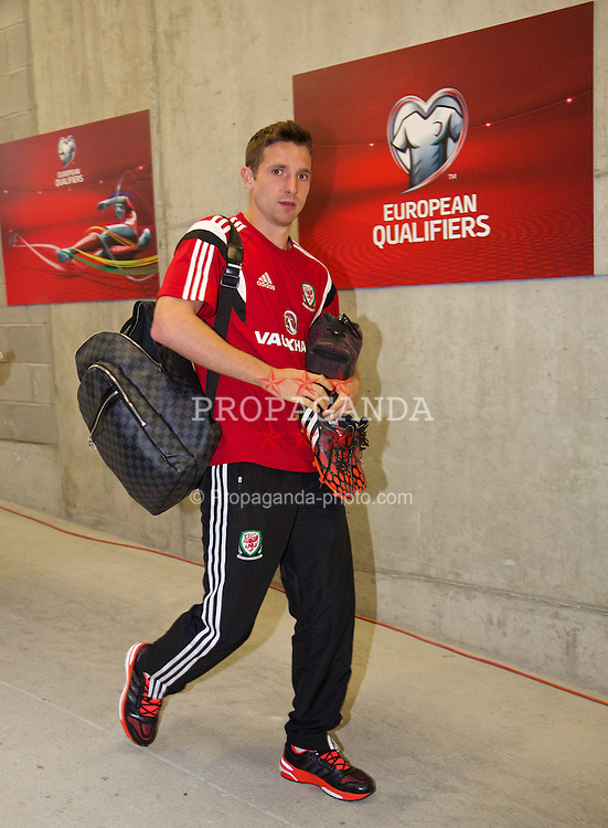 ANDORRA LA VELLA, ANDORRA - Tuesday, September 9, 2014: Wales' Joe Allen arrives before the opening UEFA Euro 2016 qualifying match against Andorra at the Camp d'Esports del M.I. Consell General. (Pic by David Rawcliffe/Propaganda)