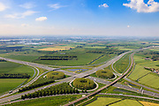 Nederland, Gelderland, Gemeente Zaltbommel, 27-05-2013; verkeersknooppunt Deil, A2 en A15 (diagonaal) - Betuweroute parallel aan de A2. Klaverturbineknooppunt. Rivier de Waal in de achtergrond.<br /> Deil junction, main motorway A15 Rotterdam Harbour - Germany crossing A2 to the South.<br /> luchtfoto (toeslag op standard tarieven)<br /> aerial photo (additional fee required)<br /> copyright foto/photo Siebe Swart