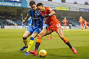 Gillingham defender Alex Lacey (4) makes a tackle, Wycombe Wanderers striker Nathan Tyson (23) during the EFL Sky Bet League 1 match between Gillingham and Wycombe Wanderers at the MEMS Priestfield Stadium, Gillingham, England on 15 December 2018.